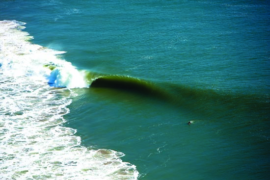 Surfing massive waves in Namibia's Skeleton Coast