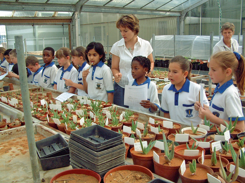 School children enjoying a day at the botanical gardens.