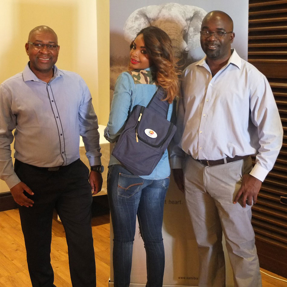 Dillish Mathews getting equipped with a backpack for her upcoming trip. With her are (left) Klemens /Awarab (Marketing Manager at NTB) and NTB CEO Digu //Naobeb