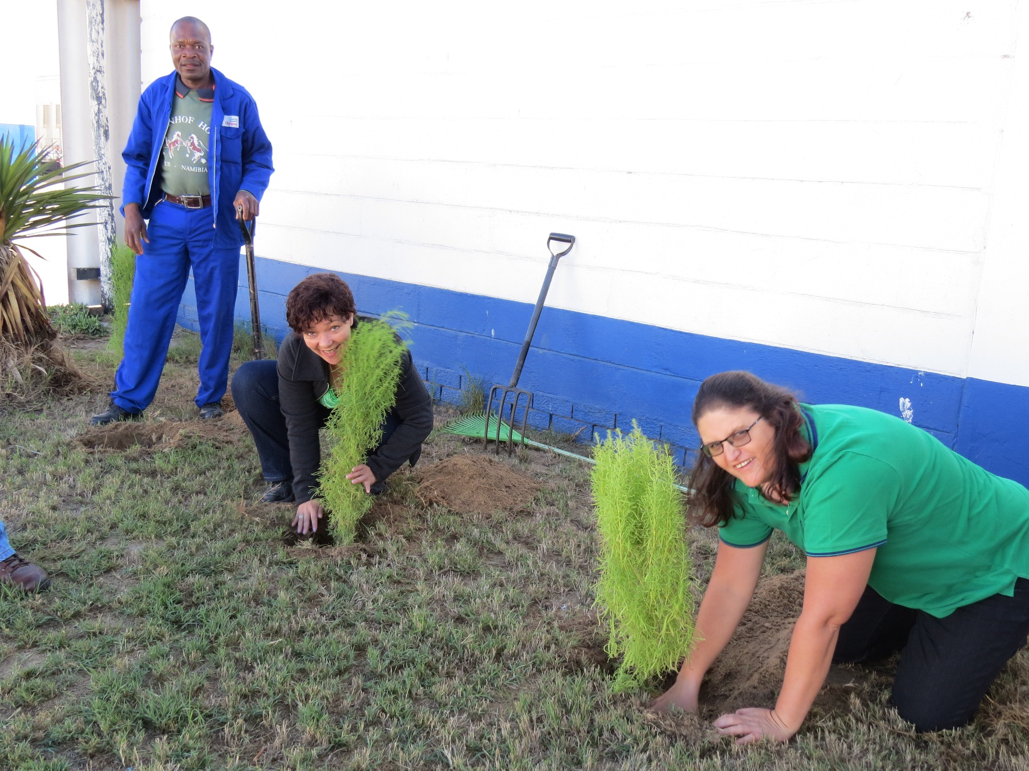 Some of the Hangana Seafood Employees who planted trees in support of O&L Environmental Week and World Environment Day. Fltr Willem Nangolo, Elize Mutilifa  and Virginia Beukes
