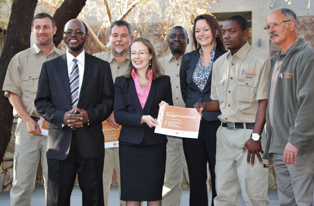 British High Commissioner, Mrs. Marianne Young handing over a certificate to one of the successful participants, and 2) MET Director of Tourism, Sem Shikongo, British High Commissioner H.E. Marianne Young, African Monarch Director Danica Smith, Trainer Johan Fourie and the four successful participants