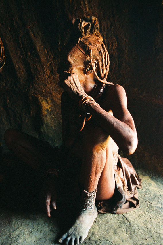 Himba woman in hut. Photo ©Ron Swilling
