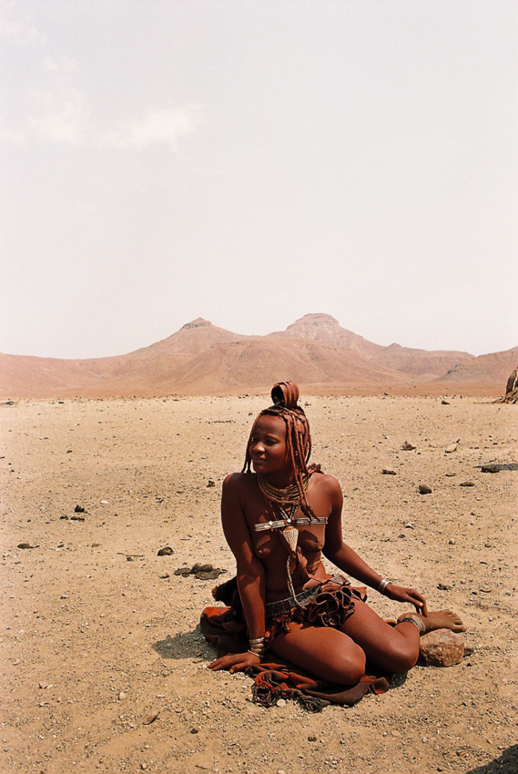 Young Himba woman. Photo ©Ron Swilling