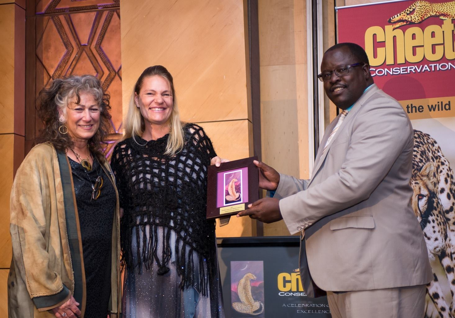 The Erindi Private Game Reserve, represented by Natasha Britz2014 Conservation Business of the Year. The award was presented by Dr. Laurie Marker, Founder and Executive Director of the Cheetah Conservation Fund, and the Honorable Minister Uahekua Herunga, Minister of Environment and Tourism. © Cheetah Conservation Fund.