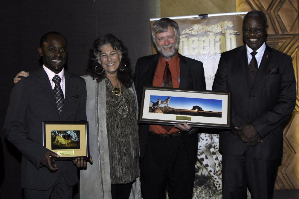Two senior staff members of the Cheetah Conservation Fund were celebrated for their 15 years of service: Matti Nghikembua, Senior Ecologist (left), and Dr. Bruce Brewer, General Manager of CCF and CCF Bush Pty Ltd (third from left). (c) Cheetah Conservation Fund - Rob Thomson