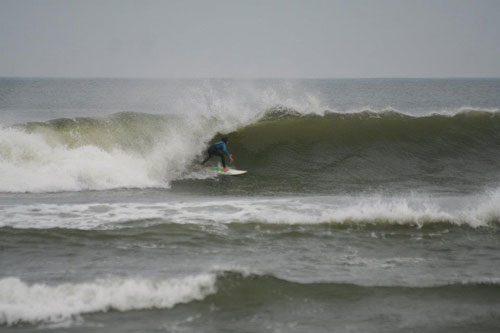 Surfing at the coast