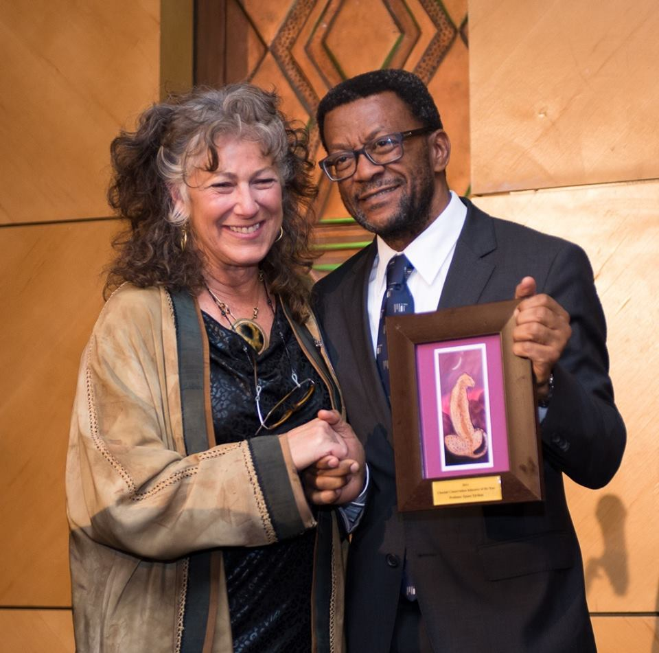 Dr. Laurie Marker presents Professor Tjama Tjivikua, Founding Rector, Polytechnic of Namibia, with the CCF 2014 Cheetah Conservation Educator of the Year Award.
