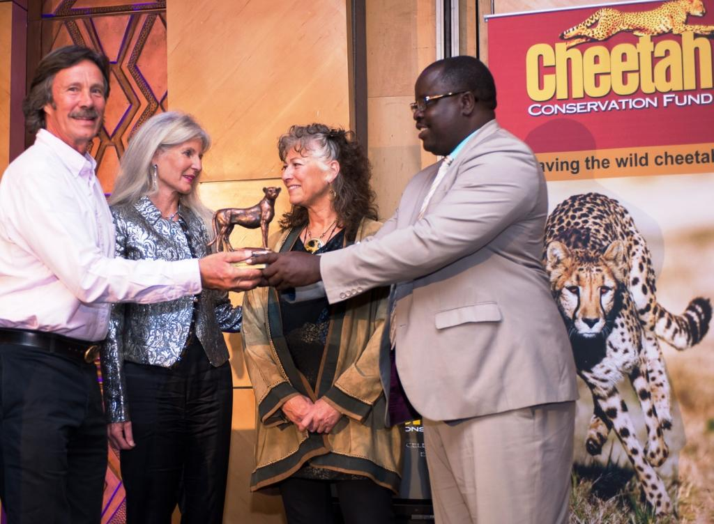 The 2014 Cheetah Conservationists of the Year award was presented to International photographers and film makers, Jonathan and Angela Scott (left), who are also called the Big Cat People. The award was presented by Dr. Laurie Marker, Founder and Executive Director of the Cheetah Conservation Fund, and the Honorable Minister Uahekua Herunga, Minister of Environment and Tourism. © Cheetah Conservation Fund.