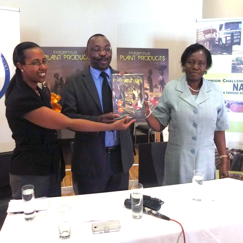 Liz Fileke, the Deputy Resident Country Director for Namibia from the Millennium Challenge Corporation (MCC), Joseph Iita, Permanent Secretary at the Ministry of Agriculture, Water and Forestry and MCA-Namibia's Chief Executive Officer Penny Akwenye officially launch the book.