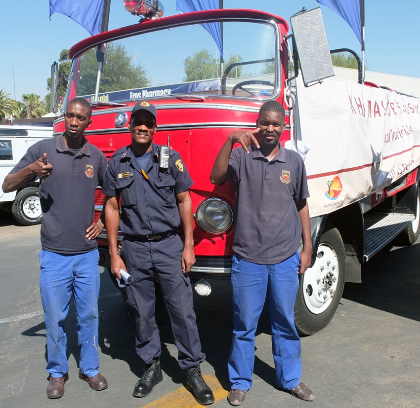 This finely looked after firetruck - affectionally called the Marauder - is 110 years old. These City of Windhoek fire officers are taking the truck on the road as part of the NTB road show. From left they are Kameuuae Herunga, Station officer Damian Makgone and Lekoelea Kautja