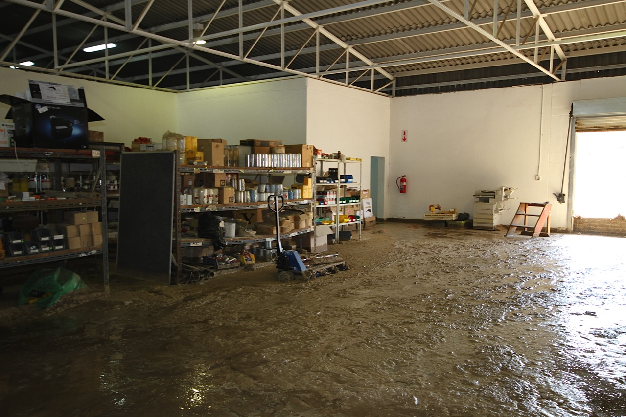 Factories and businesses were flooded by mud slides. ©Cheryl Korff