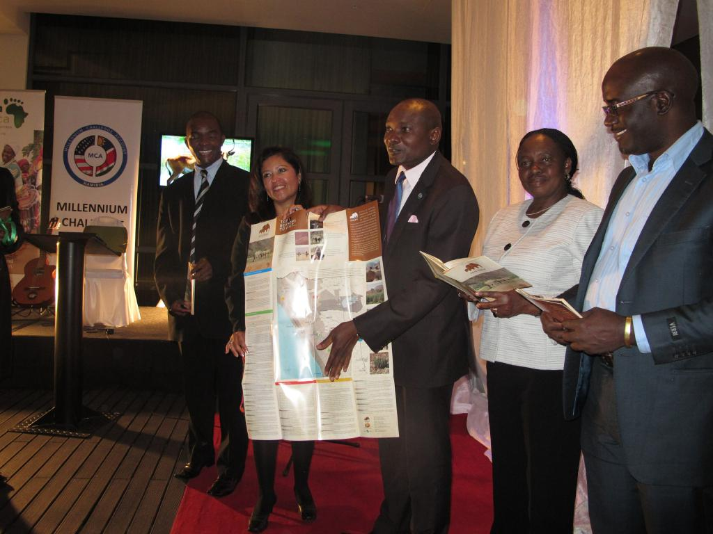 LAUNCHING THE TOURISM ROUTES (from left to right): Bornventure Mbidzo (NTB Acting CEO), Priscilla Hernandez (Acting Deputy Chief of Mission at the US Embassy), Hon. Pohamba Shifeta (Deputy Minister of Environment and Tourism), Penny Akwenye (MCA Namibia CEO), Klemens /Awarab (NTB Head of Marketing) presenting brochures and maps on the 3 new tourism routes.