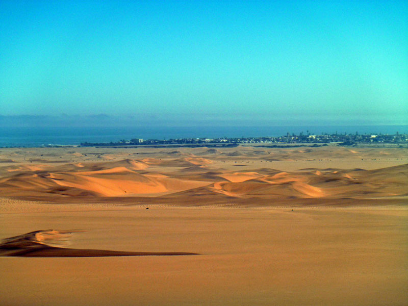 Swakopmund in the distance. Namibia. Namib desert dunes. Photo By Simon - The Nomadic Diaries
