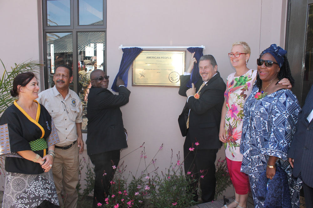 Reverend Ludwig Hausiku, Special Advisor to the Minister of Youth and U.S. Chargé d'Affaires, John Kowalski unveil the plaque to officially open the Swakopmund Arts and Craft Centre.