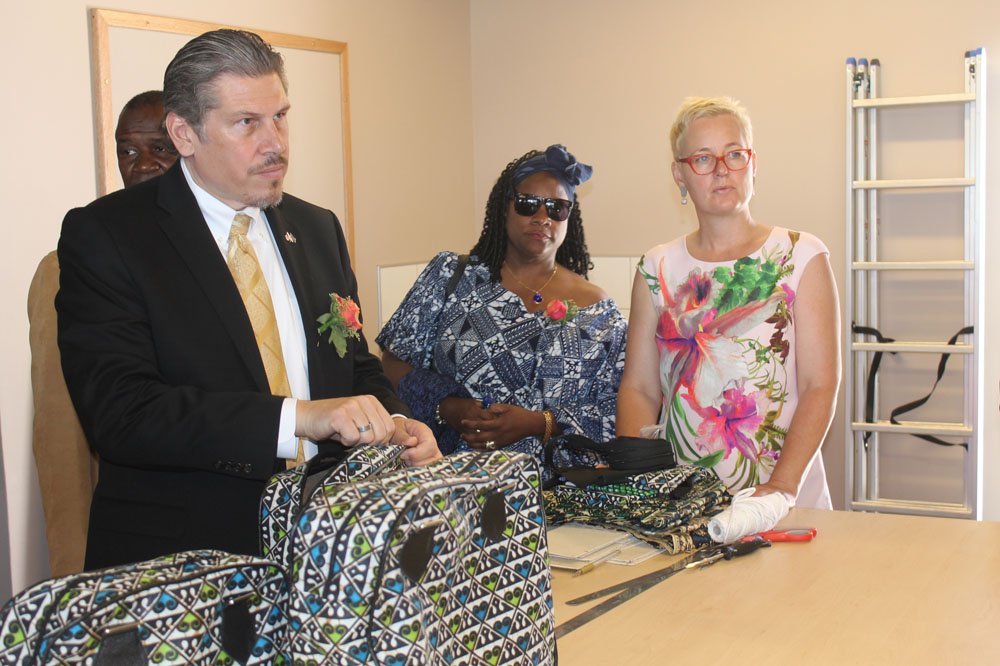 U.S. Chargé d'Affaires, John Kowalski, MCA‐N Board Member Jacky Asheeke and MCA‐N Deputy CEO for Implementation Eline van der Linden admire some of the handmade products at the centre.