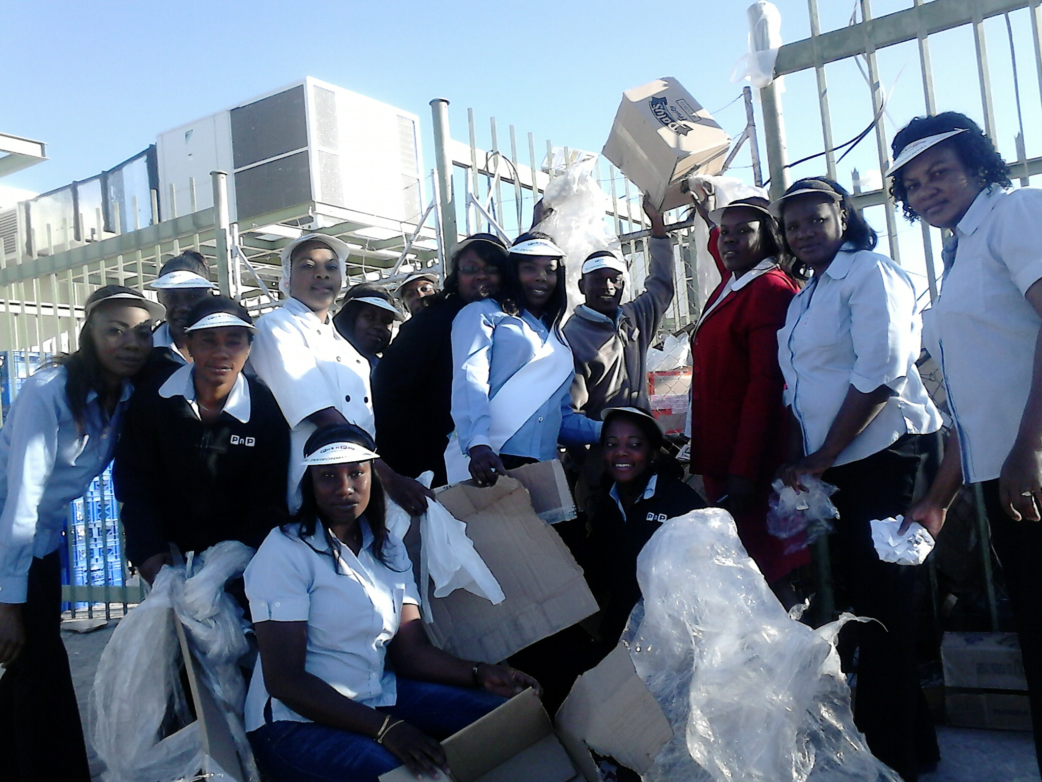 Pick n Pay Oshana staff seen here collecting boxes and plastic wrappers which come from packaging of merchandise in store. They have taken it upon themselves to collect the materials and reuse for repackaging stock or recycle as needed.