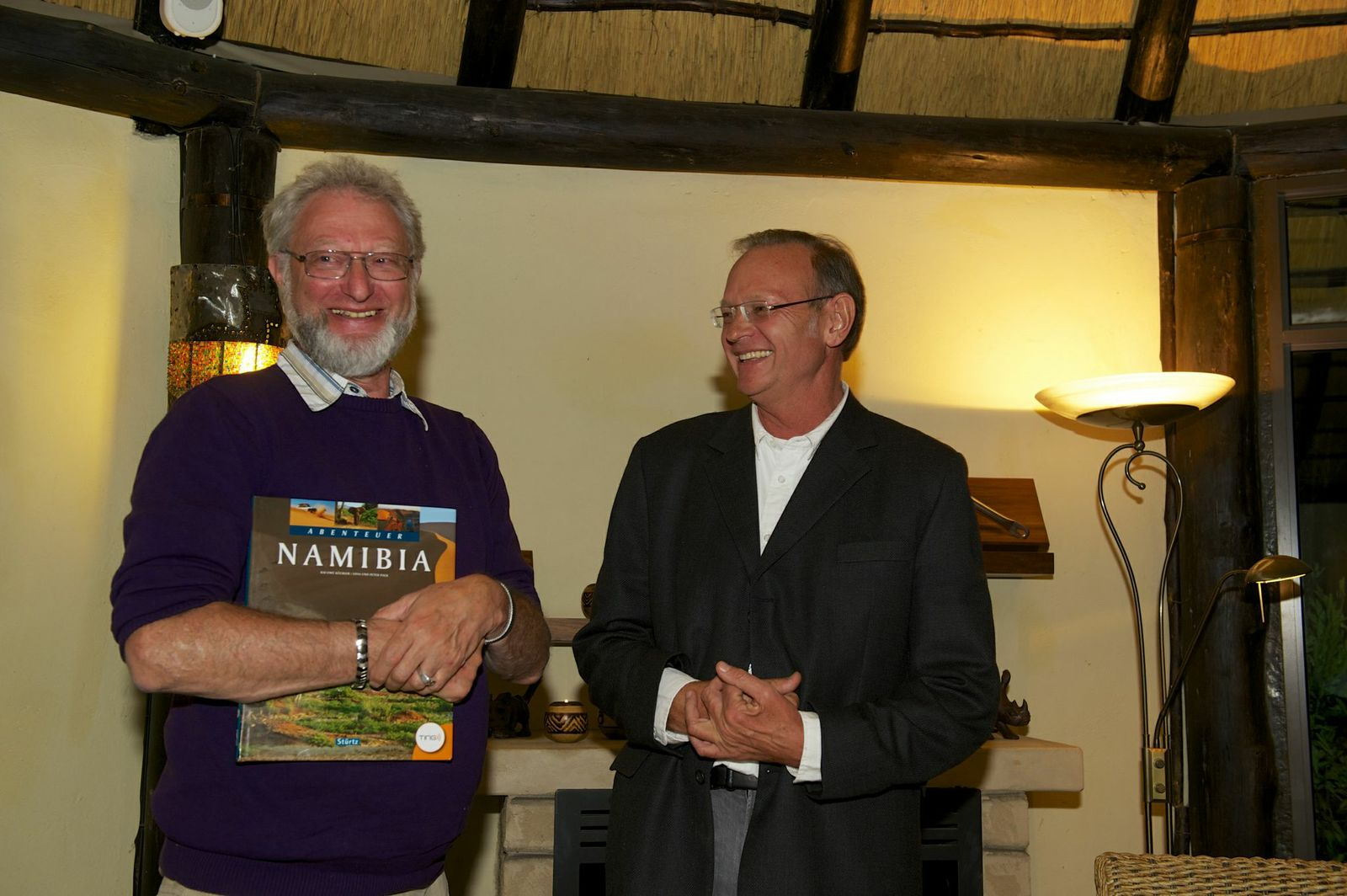 Receiving a gift at his farewell bash